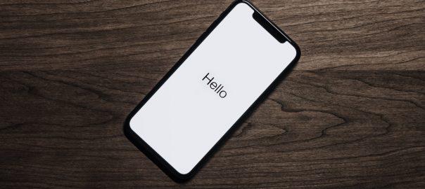 black-iphone-7-on-brown-table-699122-1.jpg