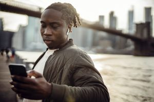 serious-black-man-using-smartphone